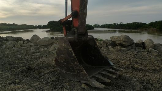 Mangrove destruction 000a excavator