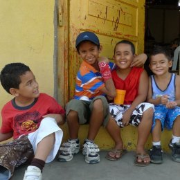"""Gringita!"" San Juan Del Sur, Nicaragua - I had walked past these boys, and the one in the blue shirt ran after me and hurriedly hugged my leg! Of course I returned to visit with the group! Z"