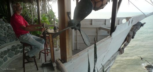 Hank piloting the fantasy boat --- Punta Prieta near Jama, Ecuador