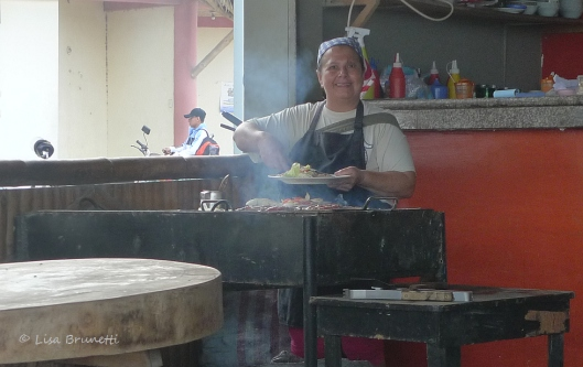She's happy to serve fresh grilled tuna for breakfast!  Playa Tarqui - Manta - Ecuador