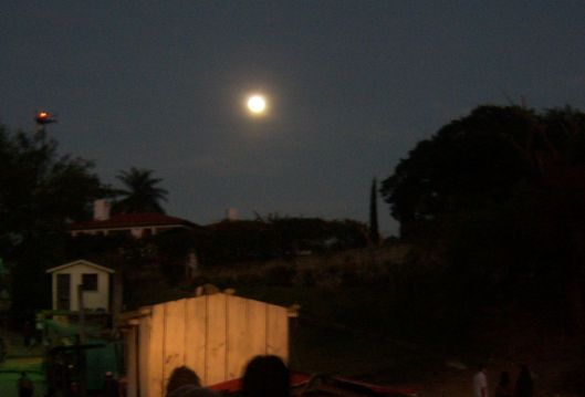 This rising full moon presided over a boat taxi ride across Lake Atitlan, Guatemala.