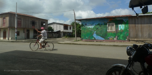 A new mural caught my eye, and as I photographed it, my friend Arturo wheeled by on his bike!