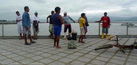P1700747 san vicente pier fishermen boots bicycle