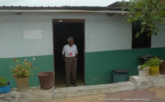 P1700894 man in doorway bahia