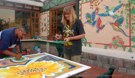 Sarah y Eloy help with the sunflower painting for their wash room.  June 2013
