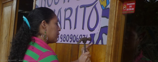 Iliana hammered the sign so very carefully!