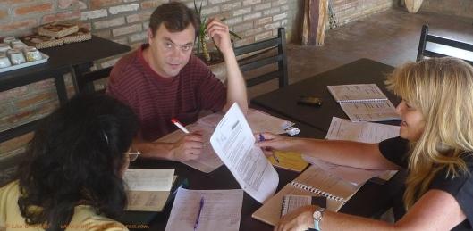 Siepre Trabajando - Always-working Sarah, Jonathan, and Susie work on tour details at Canoa Beach Hotel