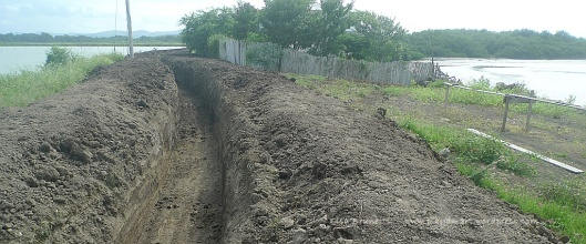 Look!  Three inches of rain on this mud all but trapped me at the gates!  (New canal for the shrimp farm!  Pipes will be installed, and the road will be restored.)