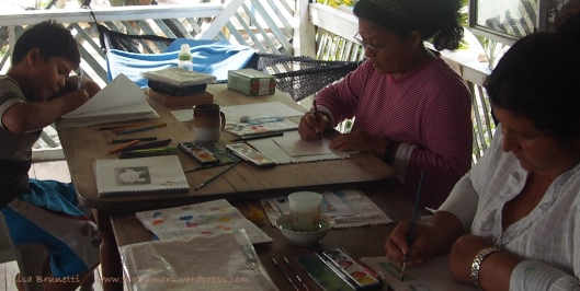 With grandchild sleeping quietly in the nearby hammock, Nely focuses on her work.