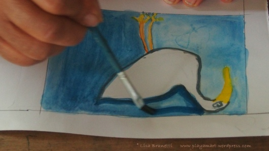 Then she painted a second layer of darker blue around the image, which actually strengthened the design!  z