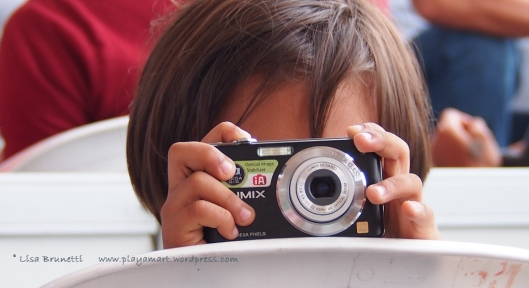 P8090365 correa jama young boy with camera