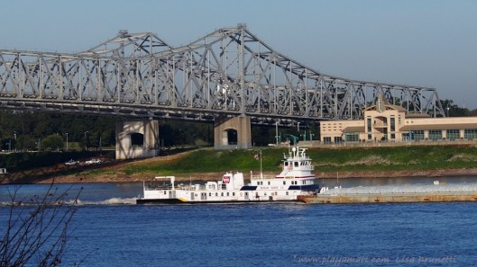 Natchez bridge, towboat and Vidalia