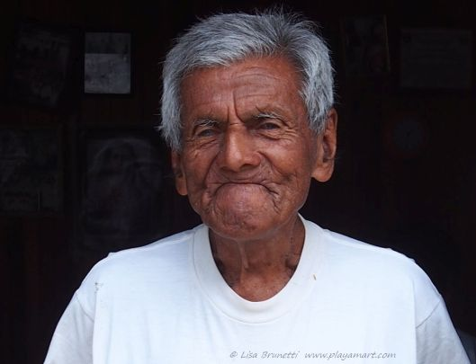 """Jose , with cataract-clouded eyes, appreciates  the chance to boast his age;  92.  He smiles, yet yearns for interaction with others.   """"Hola,"""" makes him proud to alive."""