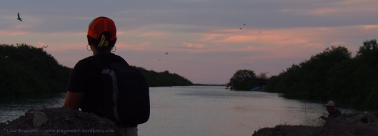 Silvana gazes toward the boca as the fisherman snags another fish!