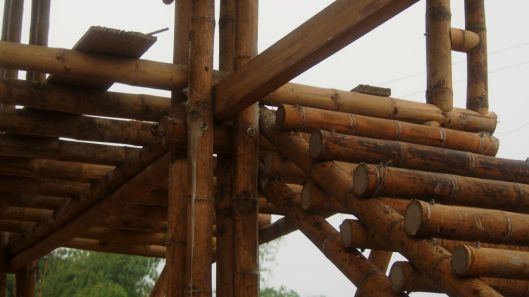 Concrete-filled sections of bamboo are bolted in place.
