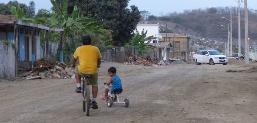 Luchy's brother and nephew enjoy a father/son outing near the hostal.
