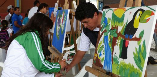 It takes courage to paint an image while the entire school watches!