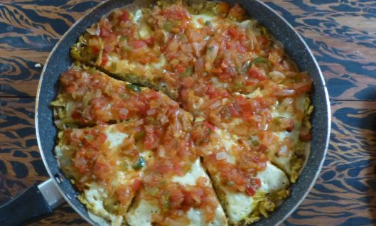 """ManaSissippi"" - a skillet experiement that went well. Green plantains provided a crispy bottom later, scrambled eggs with cheese was the middle layer, and a tomato salsa provided color and more flavor."