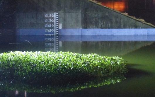 P2470448 view of represa at night water level gauge