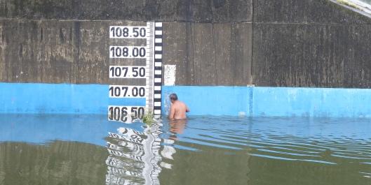 P2470761 water over the dam water level gauge y man feb 22
